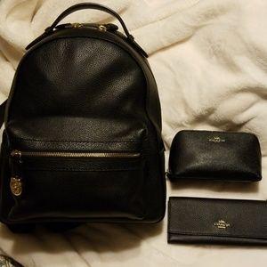 Coach backpack, wallet and sm makeup bag.